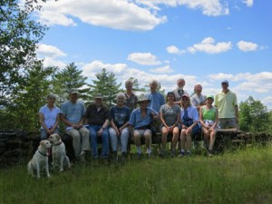 The group sitting on the long stone bench.