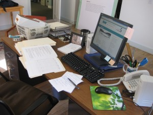 Chock full messy desk.
