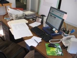 Chock full messy desk.