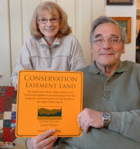 Suellen and Dom Balestra with the sign that will announce their conserved land in Lebanon.