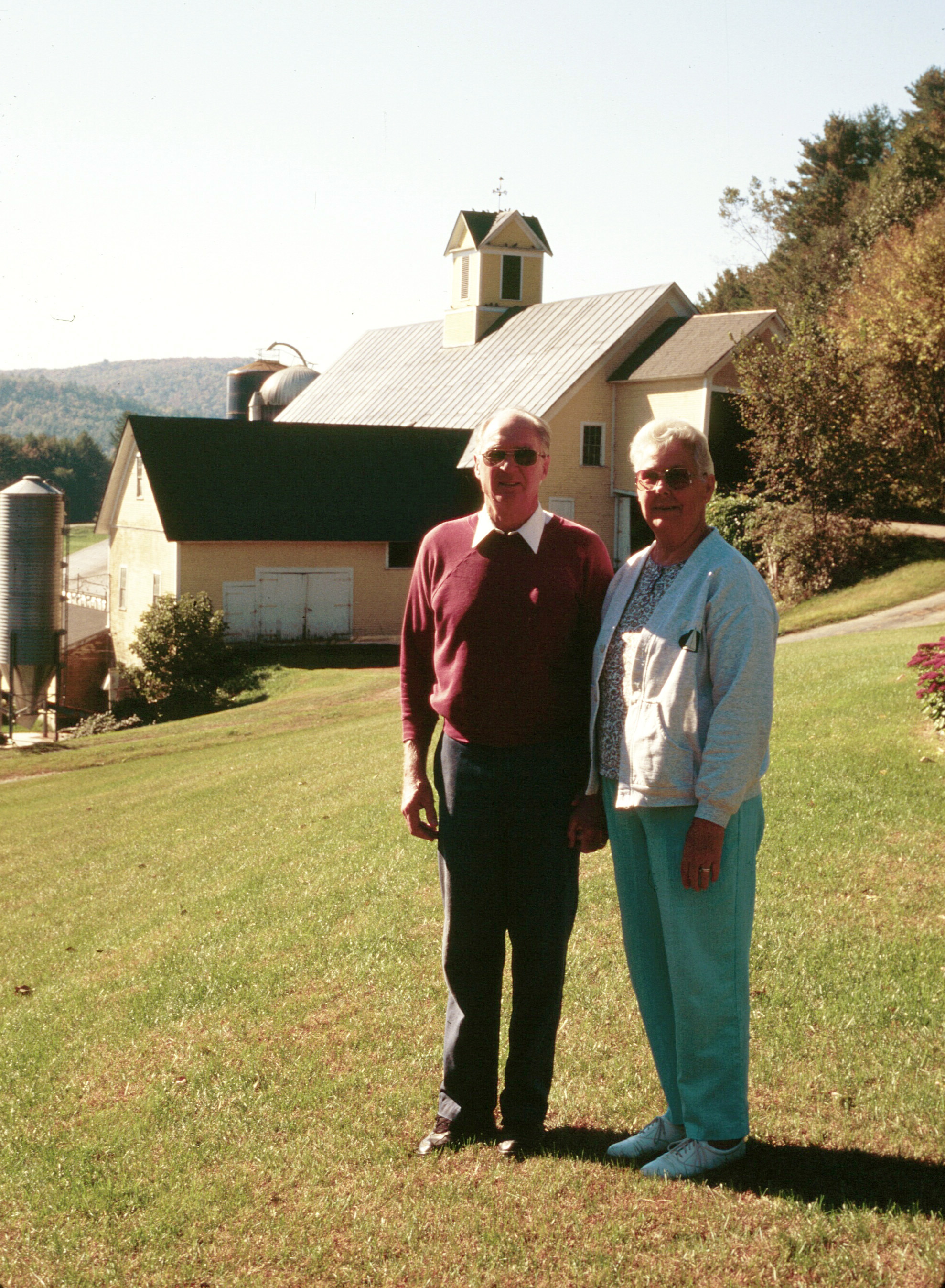 Louis and Peggy Maxfield in front of the Lemax Barn in 1996, when the farm was conserved.