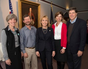 Governor Maggie Hassan (center) with UVLT's Jeanie McIntyre and John Roe (left) and Melody and Paul Cavicchi (right) owners of Smith Pond Shaker Forest in Enfield.